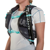 Close up of woman wearing Ultimate Direction Adventure Vesta 5.0, showing trekking poles attached to shoulder strap