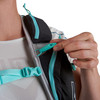 Close up of woman wearing Ultimate Direction Adventure Vesta 5.0, holding plastic rescue whistle