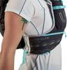 Close up of woman wearing Ultimate Direction Adventure Vesta 5.0, showing pocket on shoulder strap