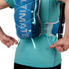 Close up of woman wearing Ultimate Direction Mountain Vesta 5.0, pulling rear adjustment cords