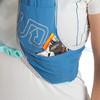 Close up of woman wearing Ultimate Direction Mountain Vesta 5.0, showing energy gels in shoulder strap pocket