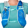 Close up of woman wearing Ultimate Direction Ultra Vesta 5.0, showing dual sternum straps