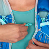 Close up of woman wearing Ultimate Direction Ultra Vesta 5.0, showing plastic sternum strap clasp