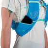 Close up of woman wearing Ultimate Direction Ultra Vesta 5.0, showing phone partially extending from shoulder strap pocket