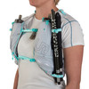 Close up of woman wearing Ultimate Direction Race Vesta 5.0, showing trekking poles attached to shoulder strap