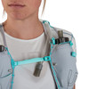 Close up of woman wearing Ultimate Direction Race Vesta 5.0, showing hydration tube tucked under sternum strap