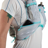 Close up of woman wearing Ultimate Direction Race Vesta 5.0, showing pocket at bottom of shoulder strap
