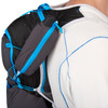 Close up of man wearing Ultimate Direction Adventure Vest 5.0, showing pocket for GPS tracker