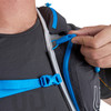 Close up of man wearing Ultimate Direction Adventure Vest 5.0, holding plastic rescue whistle