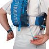 Close up of man wearing Ultimate Direction Mountain Vest 5.0, pulling rear adjustment cords