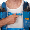 Close up of man wearing Ultimate Direction Mountain Vest 5.0, showing sternum strap buckle