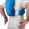 Close up of man wearing Ultimate Direction Ultra Vest 5.0, pulling on rear adjustment cords