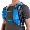 Close up of man wearing Ultimate Direction Ultra Vest 5.0, showing trekking poles attached to shoulder strap