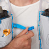 Close up of man wearing Ultimate Direction Race Vest 5.0, showing plastic sternum strap clasp