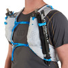 Close up of man wearing Ultimate Direction Race Vest 5.0, showing trekking poles attached to pack