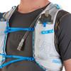 Close up of man wearing Ultimate Direction Race Vest 5.0, showing water bottles in shoulder strap pockets