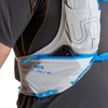 Close up of man wearing Ultimate Direction Race Vest 5.0, showing zipper pocket at bottom of shoulder strap