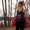 Woman wearing Ultimate Direction Women's Casual Tank, Vintage Purple, in the woods