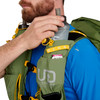 Close up of man placing water bottle in pocket of Ultimate Direction Fastpack 40