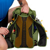 Close up of man holding Ultimate Direction Fastpack 40, pulling strap aside to show back panel