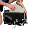 Close up of man placing laptop in pocket of Ultimate Direction Commuter Briefcase