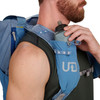 Close up of man placing water bottle in Ultimate Direction Commuter Tote