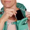 Close up of woman placing phone in pocket of Ultimate Direction FastpackHer 20
