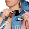 Close up of woman placing phone in pocket of Ultimate Direction FastpackHer 30