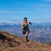 Woman running in Ultimate Direction Women's Cumulus Tank