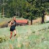 Woman running in Ultimate Direction Women's Velum Short