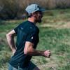 Man running in Ultimate Direction Men's Cirriform Tee
