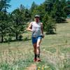 Man running in Ultimate Direction Men's Cirrus Singlet