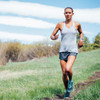 Woman running in Ultimate Direction Women's Cirrus Singlet