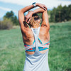 Woman wearing Ultimate Direction Women's Cirrus Singlet, with arms raised above her head