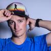 Hipster dude wearing Ultimate Direction Anton Krupicka Hat