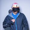 Hipster dude wearing Ultimate Direction Anton Krupicka Hat, zipping up jacket