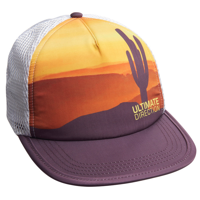 Front view of Ultimate Direction The 'Lope Hat, yellow/orange pattern, with silhouette of cactus in the foreground