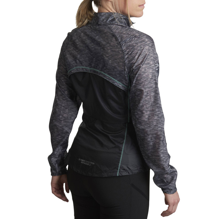 Woman wearing Ultimate Direction Women's Ventro Windshell, rear view