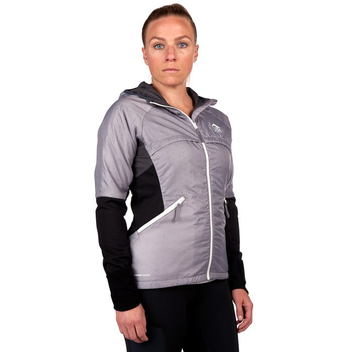 Woman wearing Ultimate Direction Women's Ventro Jacket, front view, with jacket zipped