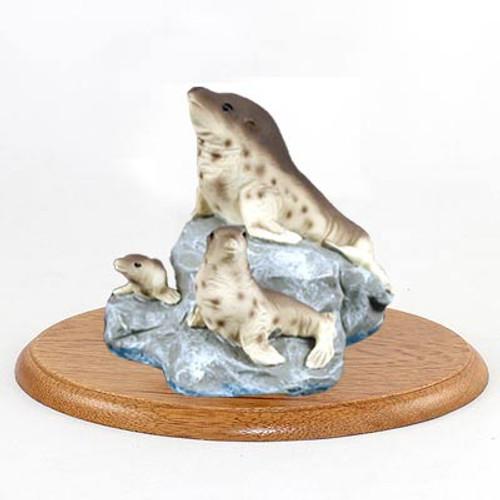 Seal Family Figurine on Wood Base