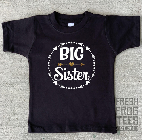 big sister with hearts on black shirt