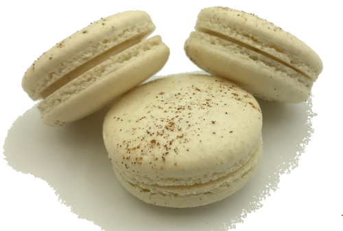 Eggnog Holiday Macarons Online - Holiday spices and Brandy infused white Chocolate ganache in a handmade macaron shell dusted with cinnamon