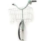 Turquois and white wall bike