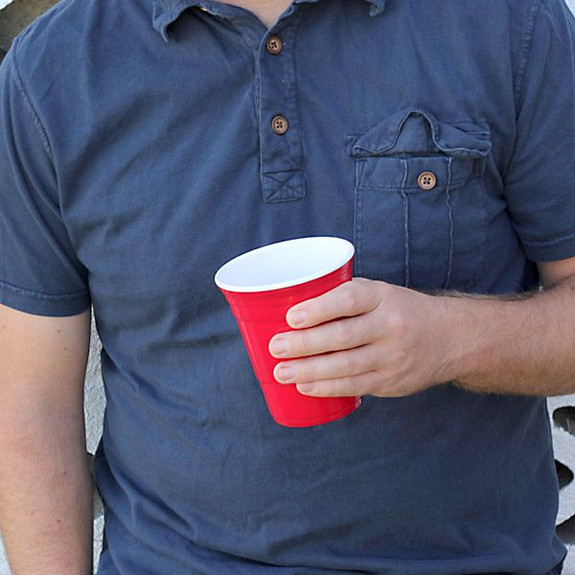 The Icon Reusable Red Cup in Hand