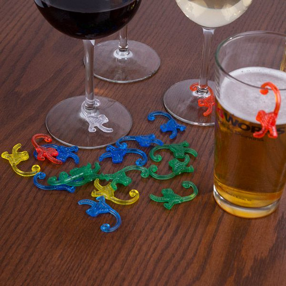 Plastic Monkey Drink Marker Charms on Table