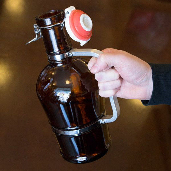Swing Top Amber Beer Growler with Stainless Steel Handle in Hand