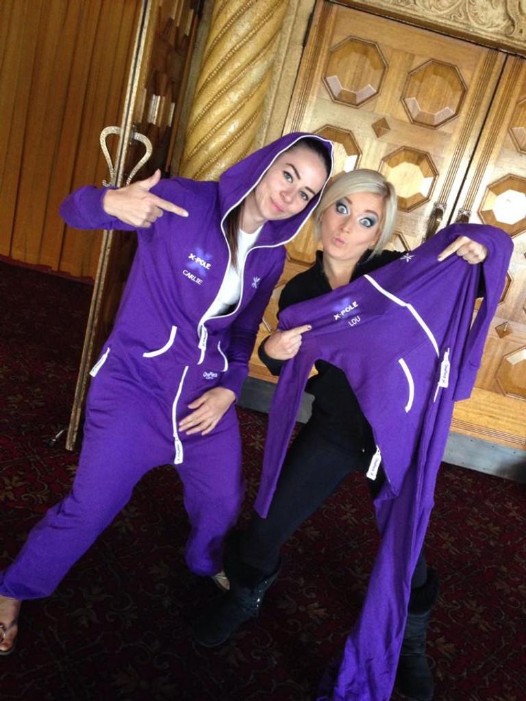 Carlie Hunter & Lou Landers with their team onesies