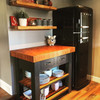 Customers image of island painted in black and with a cherry wood stain on the top and the wooden slats.
