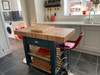 Beautiful statement butchers block island with amazing contemporary chairs.