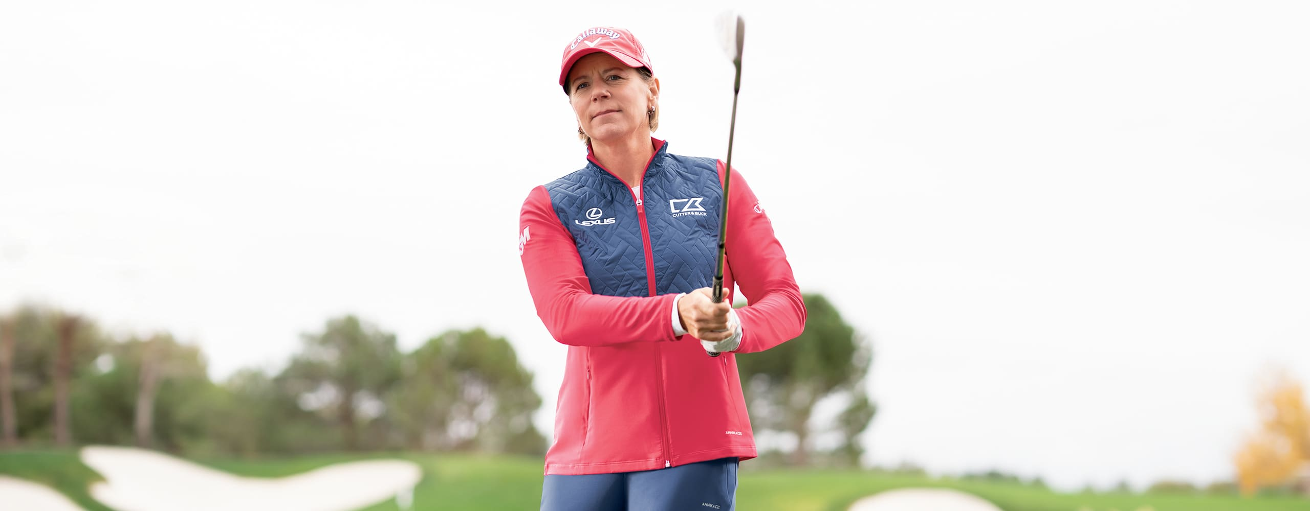 Woman golfing in Anika apparel.